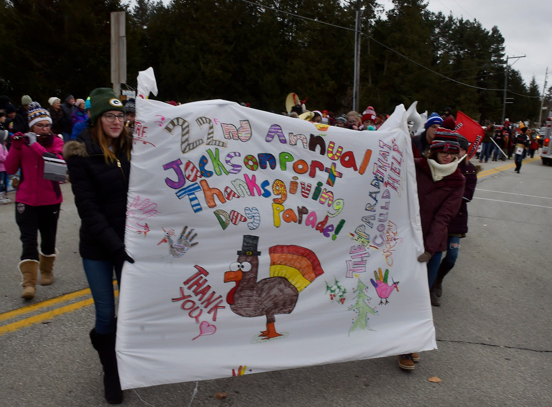 One of its largest parades (entries and audience), the Thanksgiving Day Parade in Jacksonport celebrated its 22nd year on Thursday, Nov. 22, 2018. The parade holds the unique distinction of marching four blocks and doubling-back for a second view, and at times overlapping. Left of the highway's dividing line is the beginning of the parade on its return march passing by the end of the parade at right. About 500 people watched the parade in 25 degree weather. To see more photos of the parade, visit www.doorcountyadvocate.com. Tina M. Gohr/USA TODAY NETWORK-Wisconsin