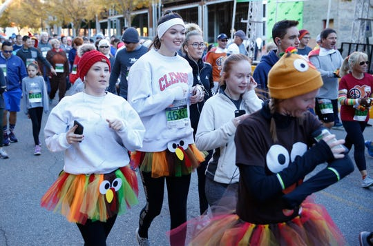 Participants start the 5k walk/run during the 2018 TreesGreenville Turkey Day 8k/5k Thursday, Nov. 22, 2018. The race began and finished on South Main Street in Greenville.