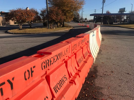 Officials hope barriers on Industrial Lane will help traffic flow on Woodruff Road