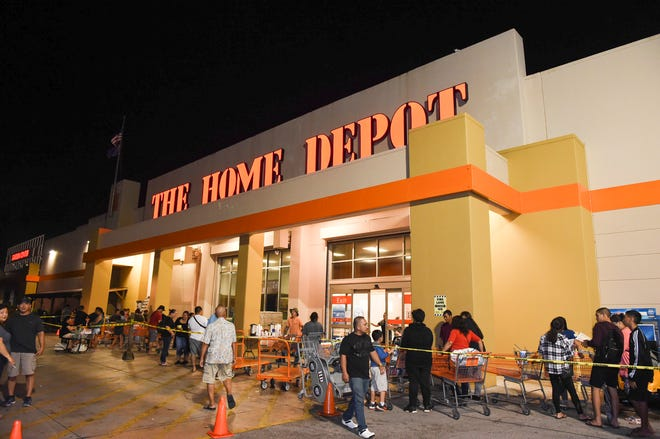 Residents wait in line for the Black Friday event at The Home Depot in Tamuning in this Nov. 23, 2018, file photo.