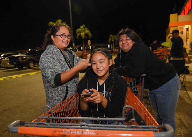 Mary Grace Alfonso, left, with her daughter Jezriella Alfonso, 12, center, and Quiana Quichocho during Black Friday at The Home Depot in Tamuning on Nov. 23, 2018.
