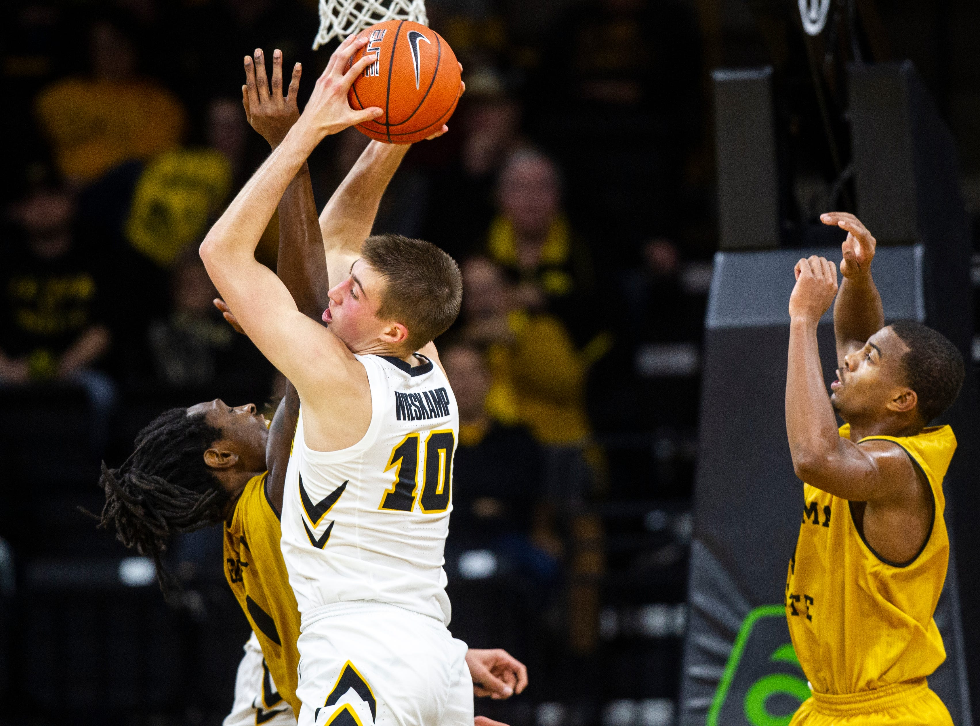 Iowa guard Joe Wieskamp (10) grabs a defensive rebound during an NCAA men's basketball game on Wednesday, Nov. 21, 2018, at Carver-Hawkeye Arena in Iowa City.