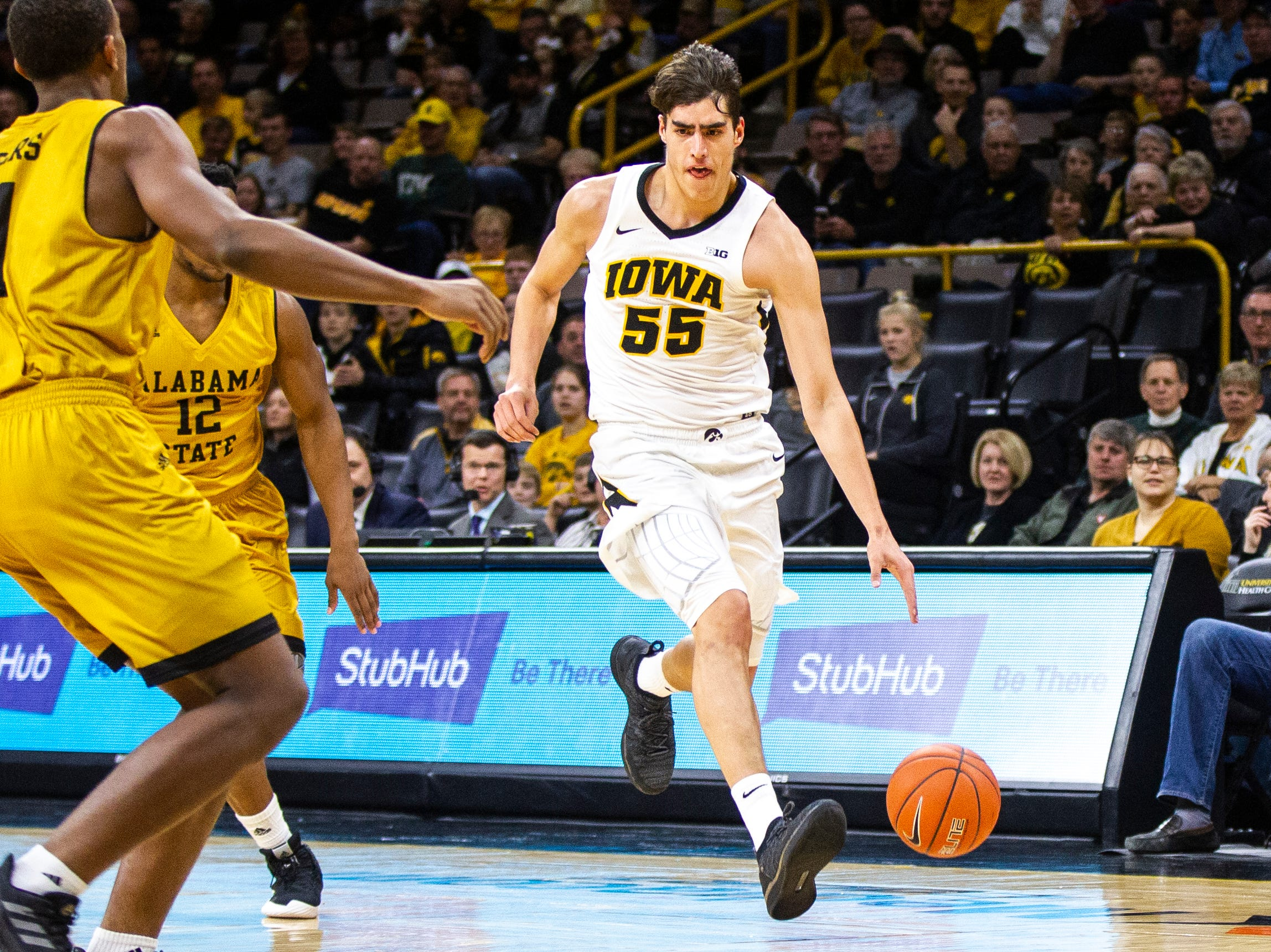 Iowa forward Luka Garza (55) drives to the hoop during an NCAA men's basketball game on Wednesday, Nov. 21, 2018, at Carver-Hawkeye Arena in Iowa City.