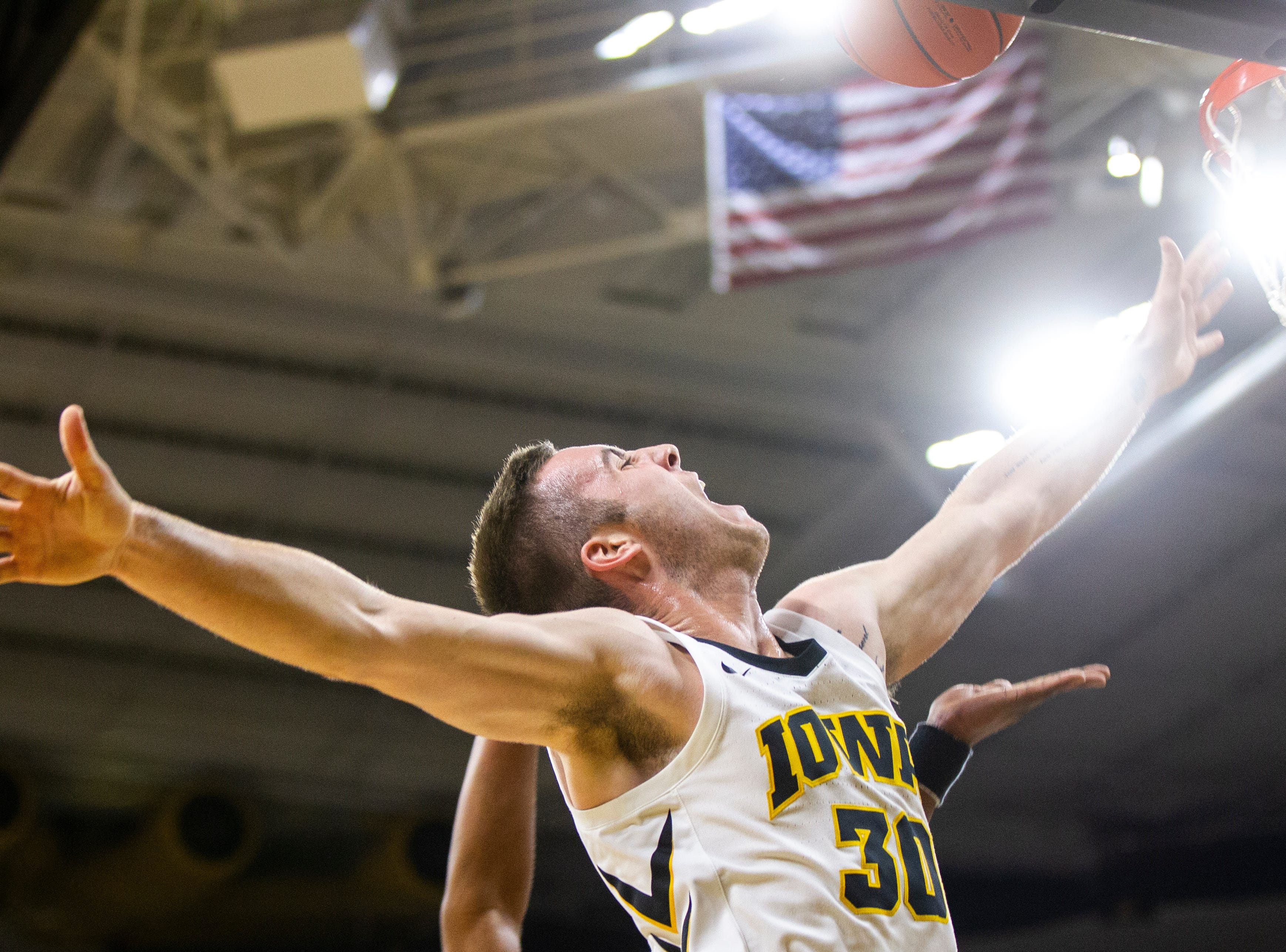 Iowa guard Connor McCaffery (30) gets fouled on his way to the hoop during an NCAA men's basketball game on Wednesday, Nov. 21, 2018, at Carver-Hawkeye Arena in Iowa City.