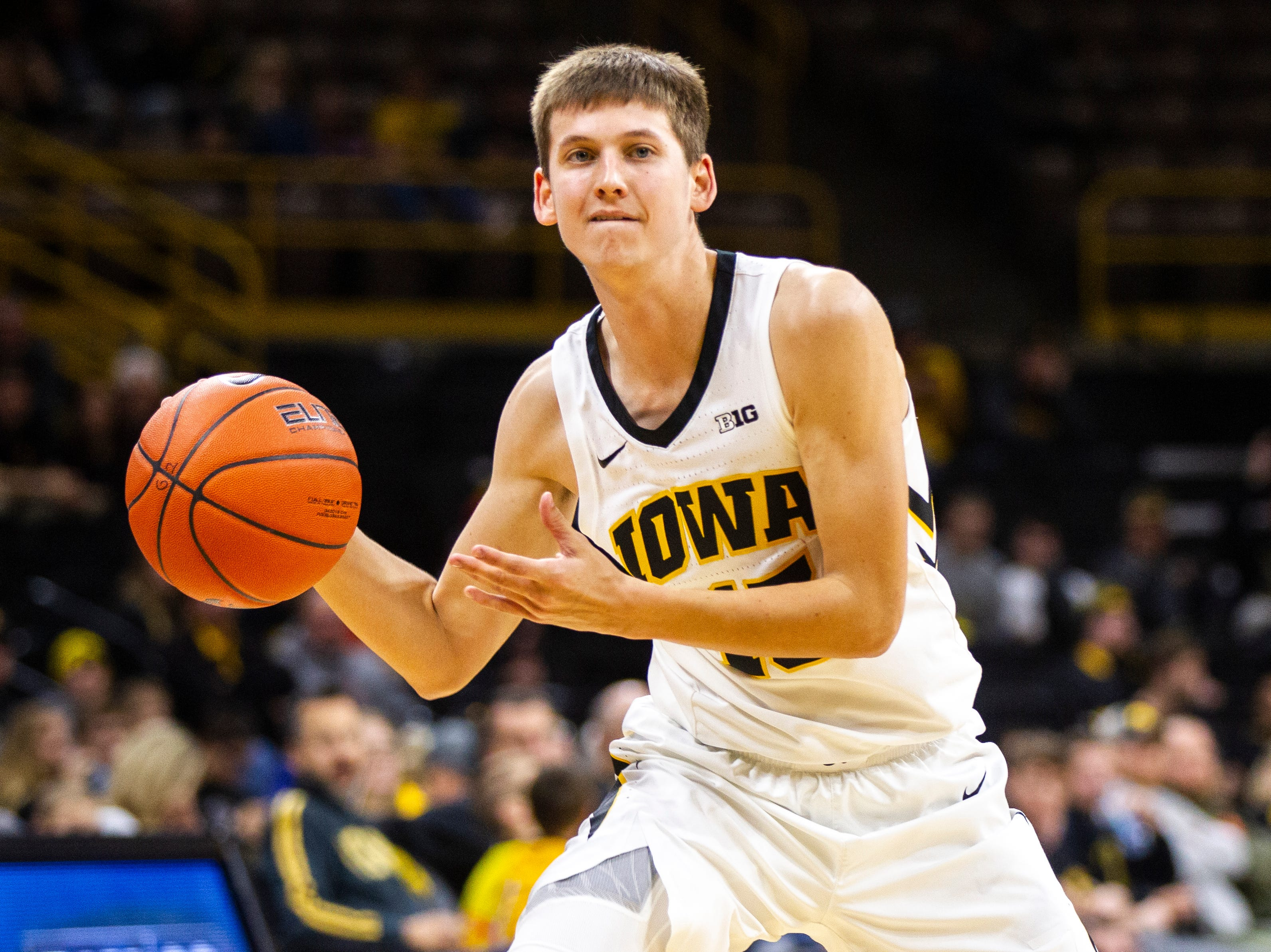 Iowa guard Austin Ash (13) passes to a teammate during an NCAA men's basketball game on Wednesday, Nov. 21, 2018, at Carver-Hawkeye Arena in Iowa City.