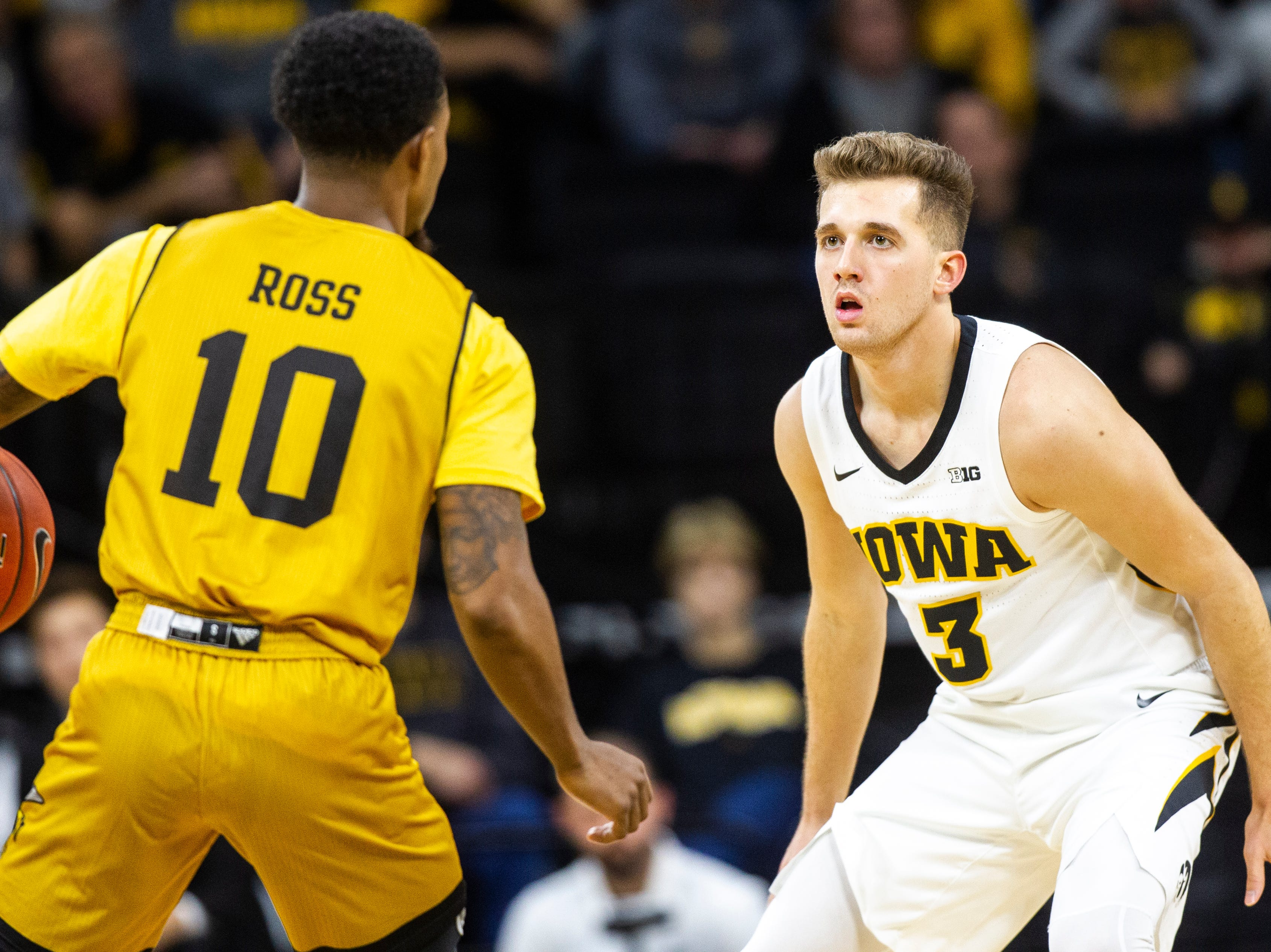 Iowa guard Jordan Bohannon (3) defends Alabama State's Jacoby Ross (10) during an NCAA men's basketball game on Wednesday, Nov. 21, 2018, at Carver-Hawkeye Arena in Iowa City.