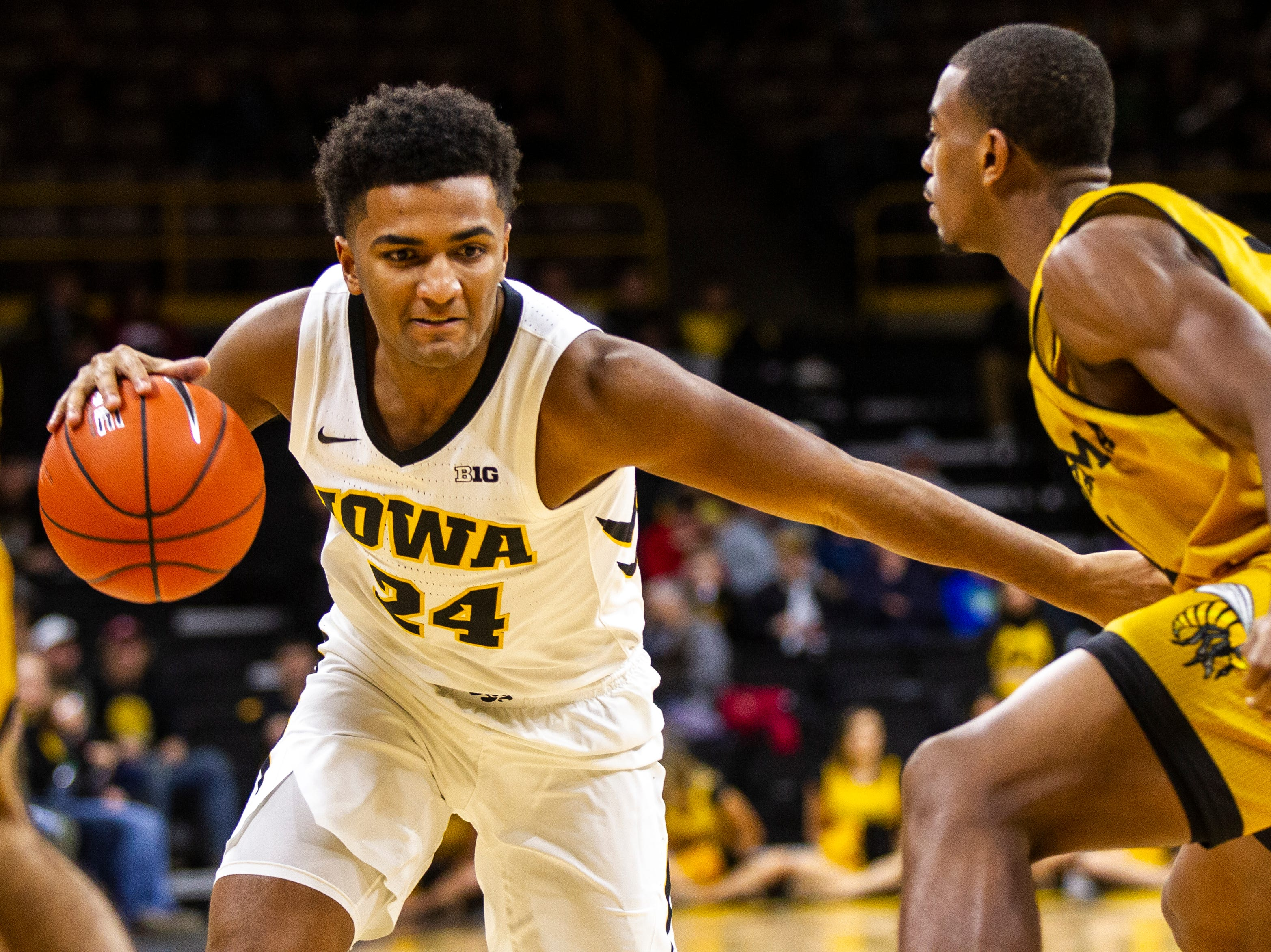 Iowa guard Nicolas Hobbs (24) drives to the hoop during an NCAA men's basketball game on Wednesday, Nov. 21, 2018, at Carver-Hawkeye Arena in Iowa City.
