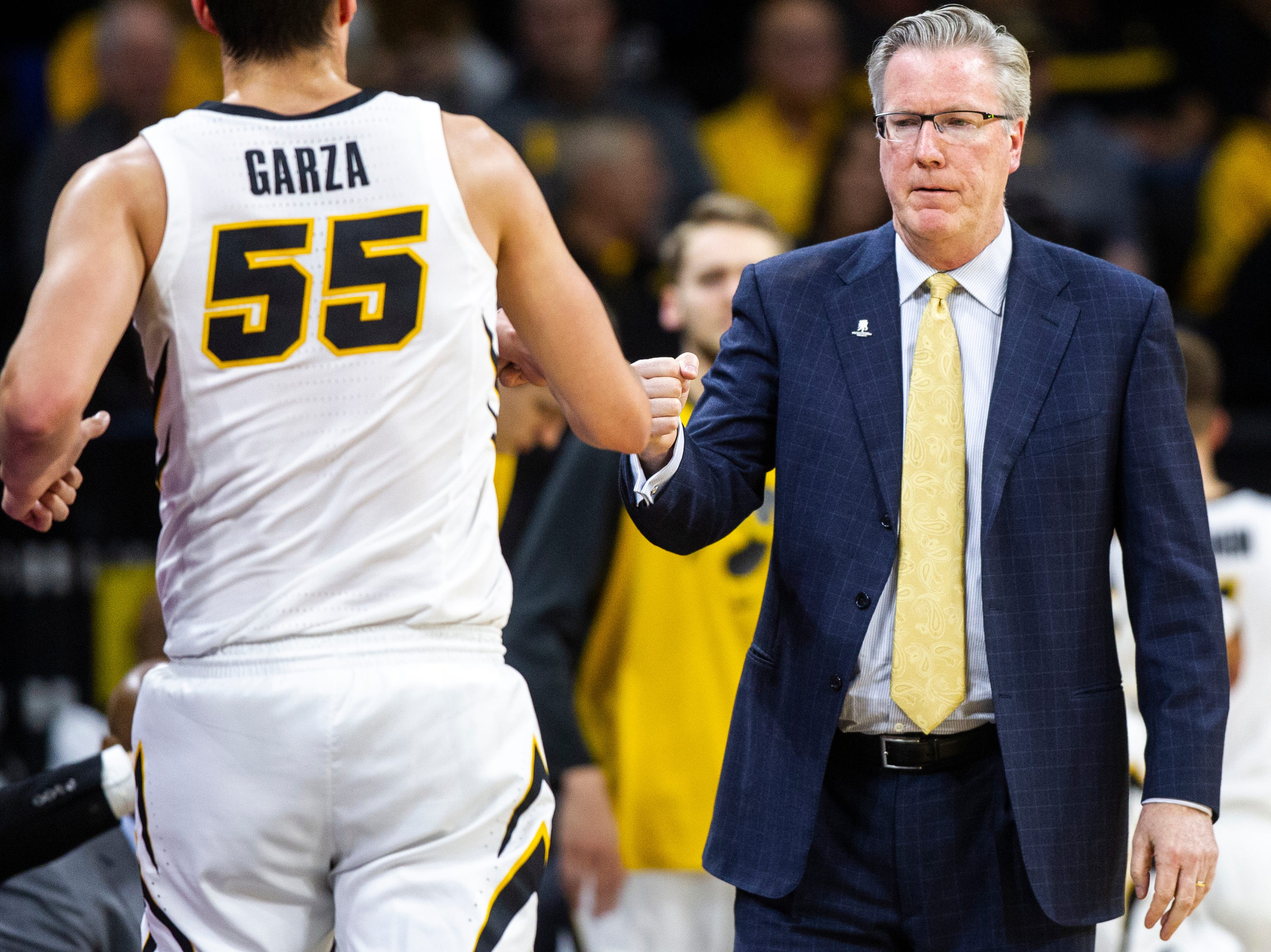 Iowa men's basketball head coach Fran McCaffery bumps fists with Iowa forward Luka Garza (55) during an NCAA men's basketball game on Wednesday, Nov. 21, 2018, at Carver-Hawkeye Arena in Iowa City.