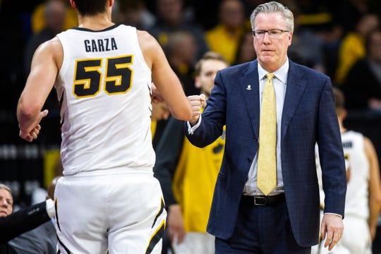 Iowa men's basketball head coach Fran McCaffery bumps fists with Iowa forward Luka Garza (55) during an NCAA men's basketball game on Wednesday, Nov. 21, 2018, at Carver-Hawkeye Arena in Iowa City.