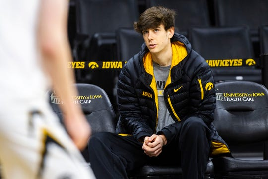 Iowa City West senior Patrick McCaffery sits on the bench during warmups before an NCAA men's basketball game on Wednesday, Nov. 21, 2018, at Carver-Hawkeye Arena in Iowa City.