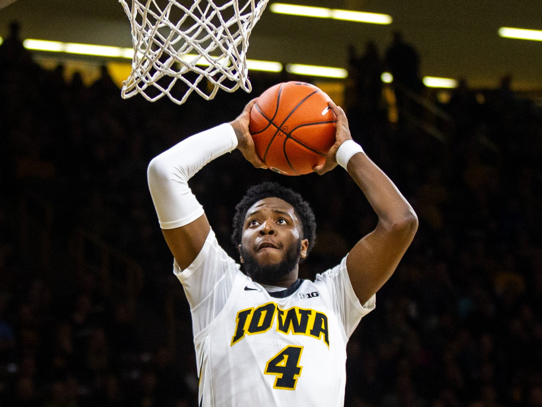 Iowa guard Isaiah Moss (4) dunks during an NCAA men's basketball game on Wednesday, Nov. 21, 2018, at Carver-Hawkeye Arena in Iowa City.
