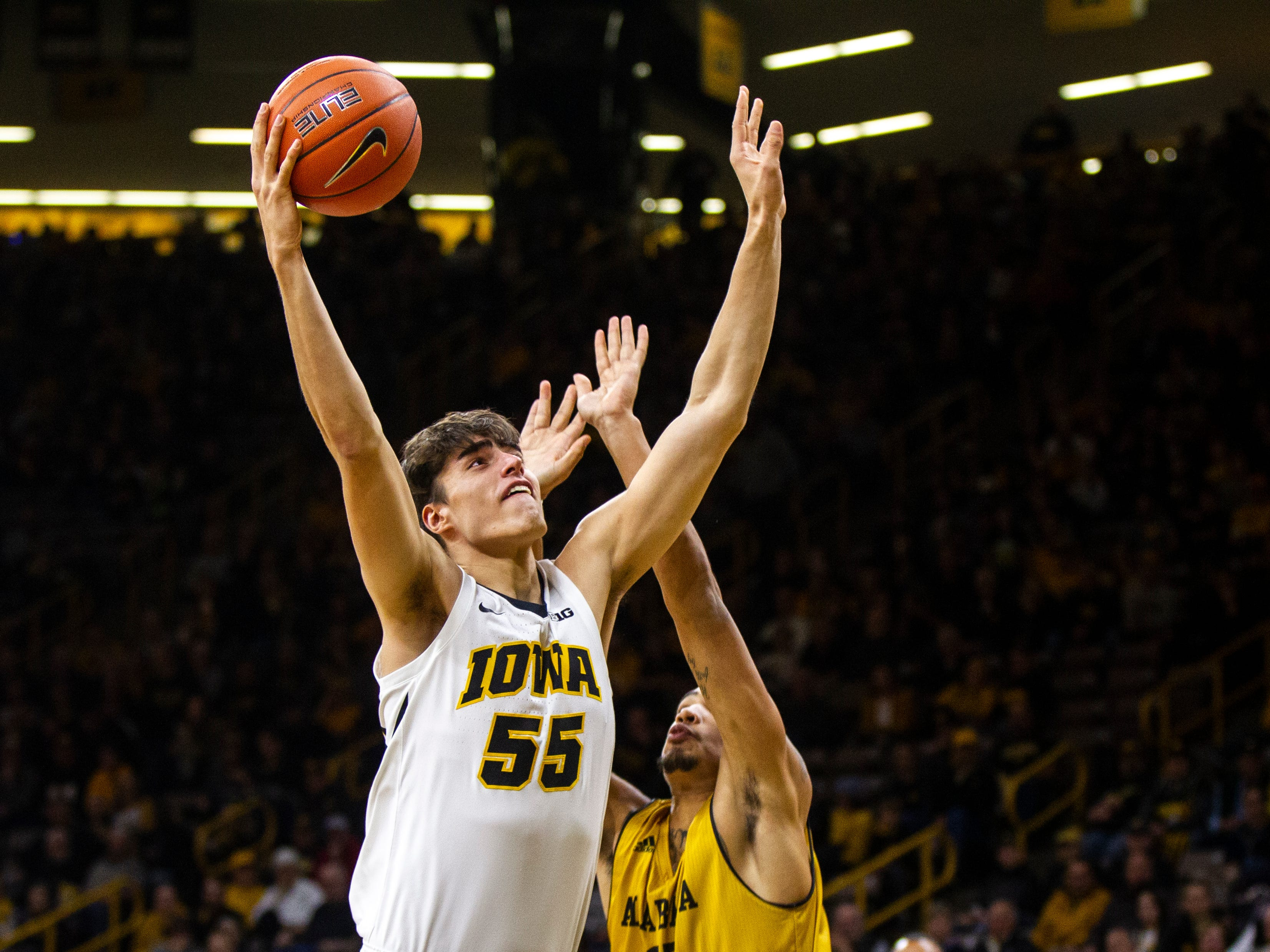 Iowa forward Luka Garza (55) attempts a shot during an NCAA men's basketball game on Wednesday, Nov. 21, 2018, at Carver-Hawkeye Arena in Iowa City.
