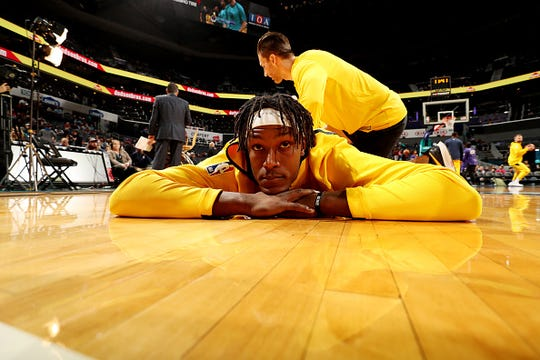 Myles Turner #33 of the Indiana Pacers stretches prior to the game against the Indiana Pacers on November 21, 2018 at Spectrum Center in Charlotte, North Carolina.