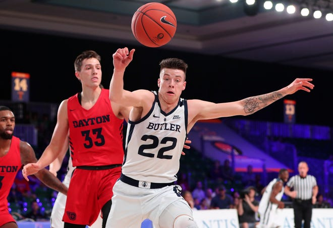 Nov 21, 2018; Paradise Island, BAHAMAS; Butler Bulldogs forward Sean McDermott (22) tries to control the ball in front of Dayton Flyers forward Ryan Mikesell (33)  during the first half at Imperial Arena.