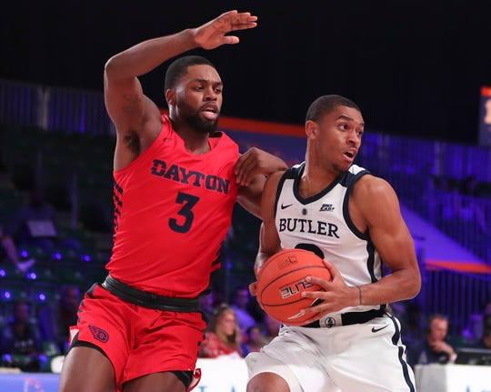 Nov 21, 2018; Paradise Island, BAHAMAS; Butler Bulldogs guard Aaron Thompson (2) looks to pass as Dayton Flyers guard Trey Landers (3) defends during the first half at Imperial Arena.