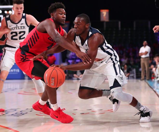 Nov 21, 2018; Paradise Island, BAHAMAS; Butler Bulldogs guard Kamar Baldwin (3) drives to the basket as Dayton Flyers guard Jordan Davis (4) defends during the first half at Imperial Arena.