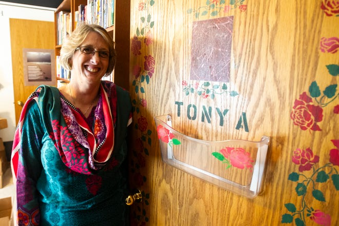 Amy Nicholson stands next to a door decorated with her daughter's name, Tonya, on Wednesday, Nov. 21, 2018, in Iowa City. Her daughter's room now serves as Nicholson's home office and is still decorated with the original design.