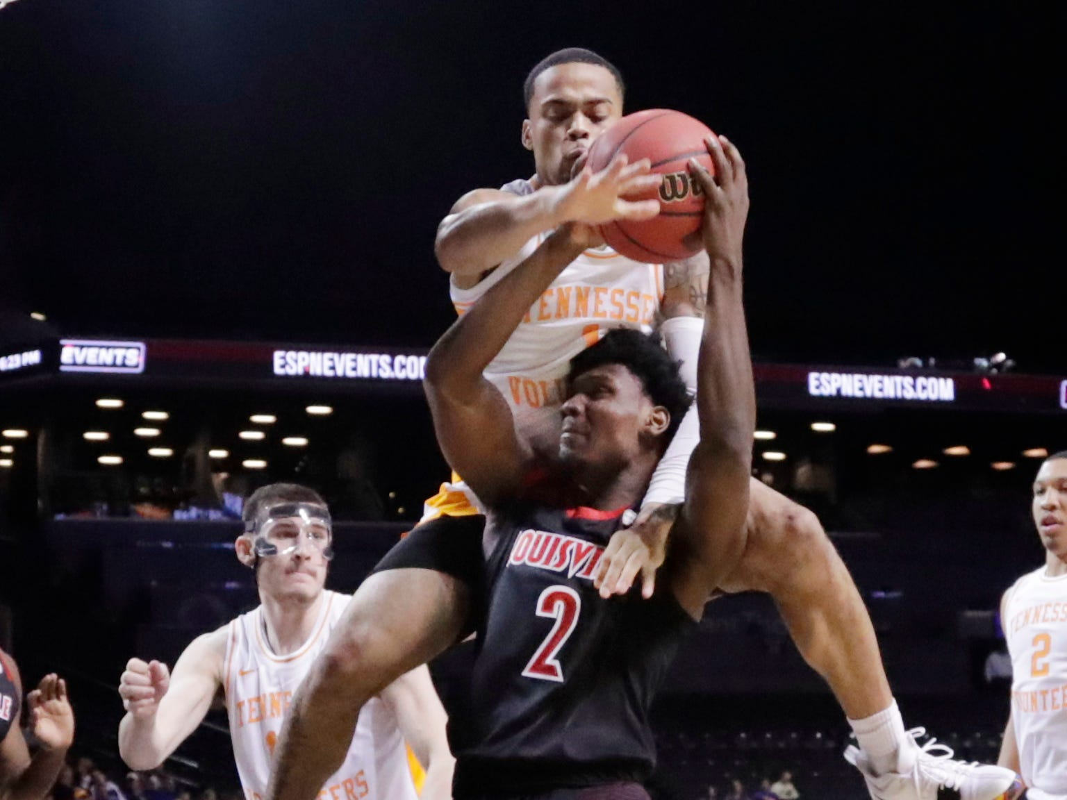 Tennessee's Lamonte Turner (1) defends Louisville's Darius Perry (2) during the second half of an NCAA college basketball game in the NIT Season Tip-Off tournament Wednesday, Nov. 21, 2018, in New York. Tennessee won 92-81. (AP Photo/Frank Franklin II)