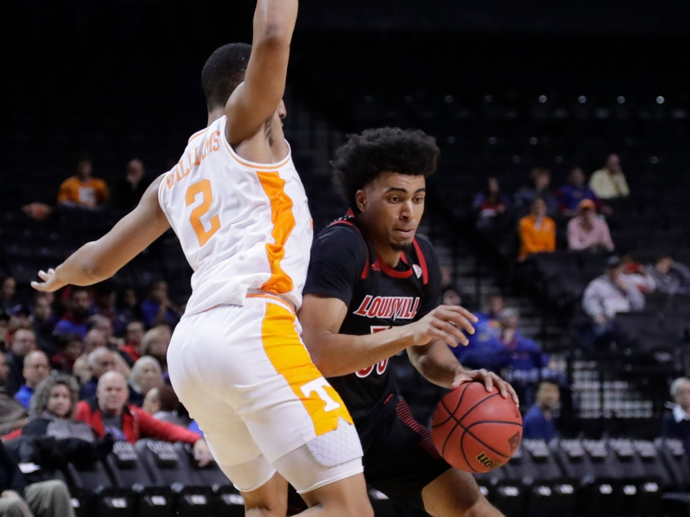 Tennessee's Grant Williams defends Louisville's Jordan Nwora during the second half in the NIT Season Tip-Off tournament Nov. 21, 2018, in New York. Tennessee won 92-81.