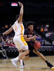 Louisville's Jordan Nwora drives against Tennessee's Grant Williams on Nov. 21.