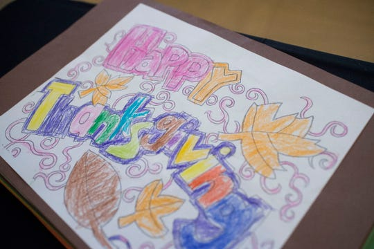 A Thanksgiving coloring page sits at Knoxville Area Rescue Ministries annual Thanksgiving meal in downtown Knoxville Thursday, Nov. 22, 2018.