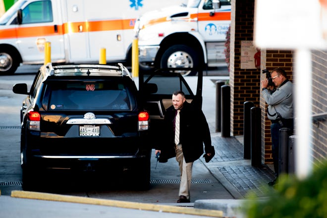 Investigators examine a Toyota 4Runner at the scene in front of East Tennessee Children's Hospital in Fort Sanders in Knoxville, Tennessee on Thursday, November 22, 2018.