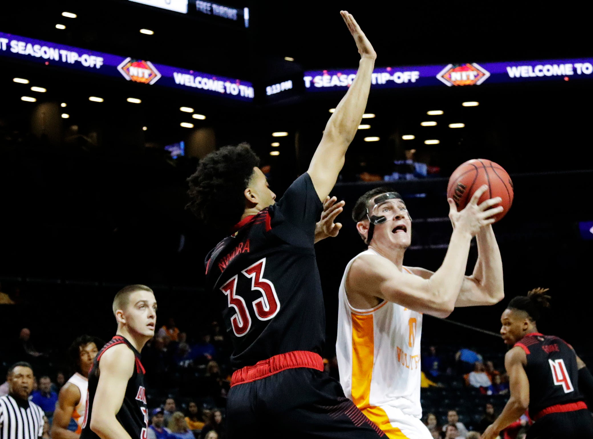Louisville's Jordan Nwora (33) defends Tennessee's John Fulkerson (10) during the first half of an NCAA college basketball game in the NIT Season Tip-Off tournament Wednesday, Nov. 21, 2018, in New York. (AP Photo/Frank Franklin II)