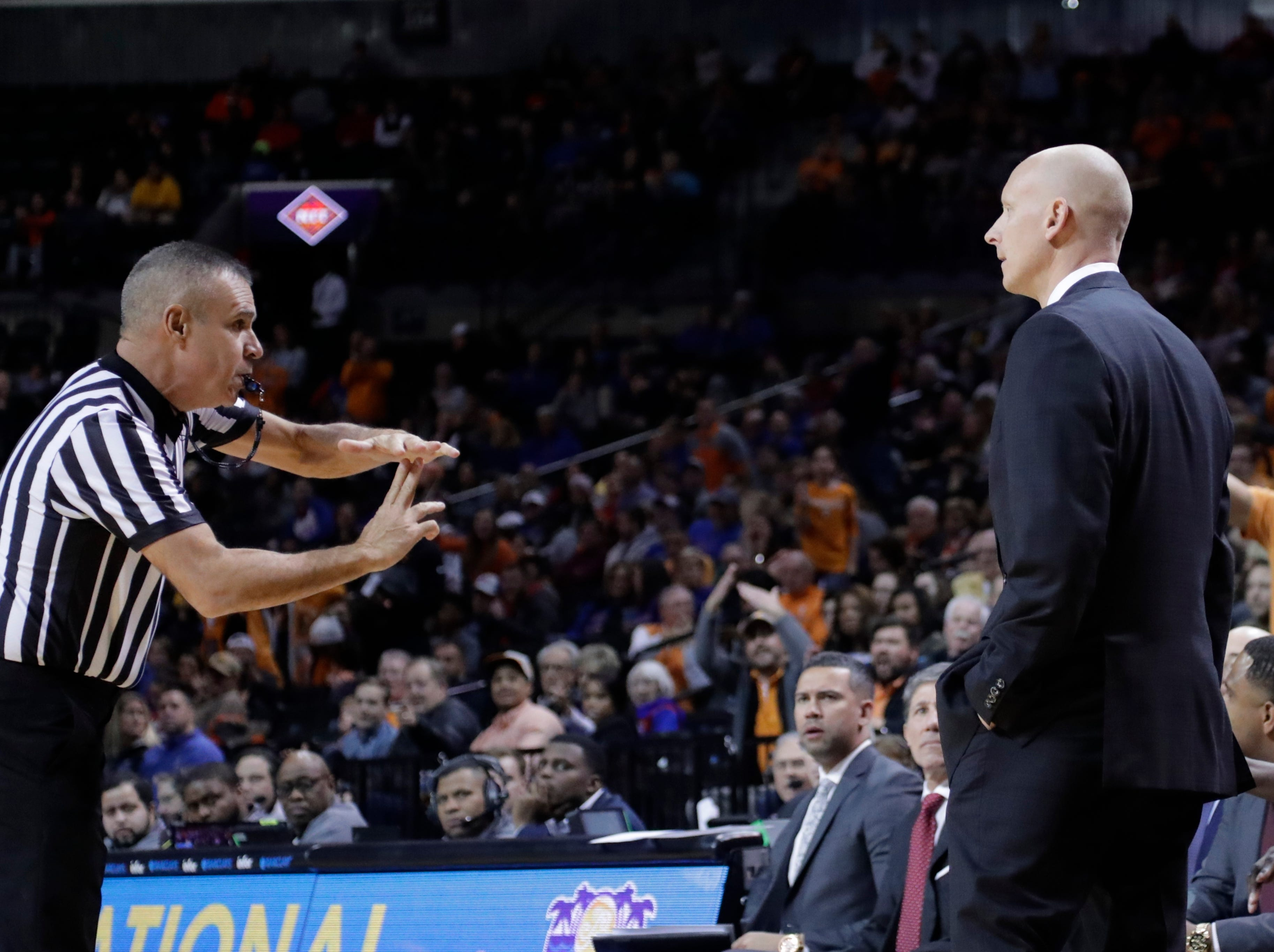 Louisville head coach Chris Mack, right, reacts as he is getting a technical foul from the referee during the second half of an NCAA college basketball game against Tennessee in the NIT Season Tip-Off tournament Wednesday, Nov. 21, 2018, in New York. Tennessee won 92-81. (AP Photo/Frank Franklin II)