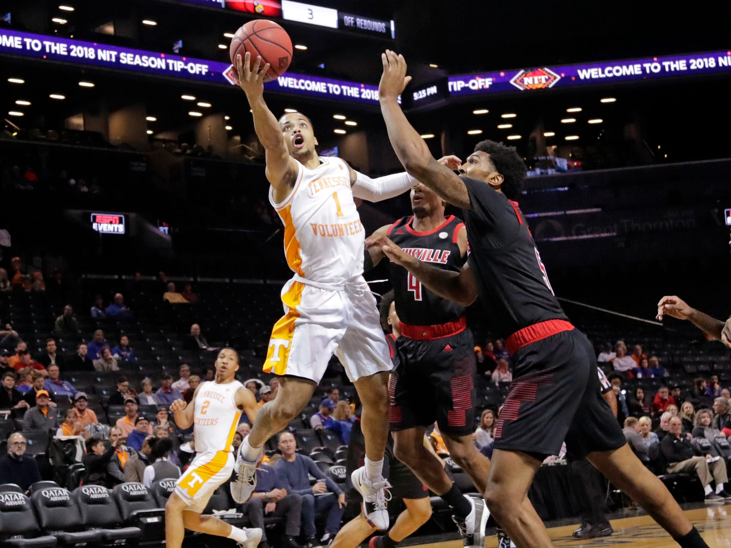 Tennessee's Lamonte Turner, left, drives past Louisville's Malik Williams, right, during the first half of an NCAA college basketball game in the NIT Season Tip-Off tournament Wednesday, Nov. 21, 2018, in New York. (AP Photo/Frank Franklin II)