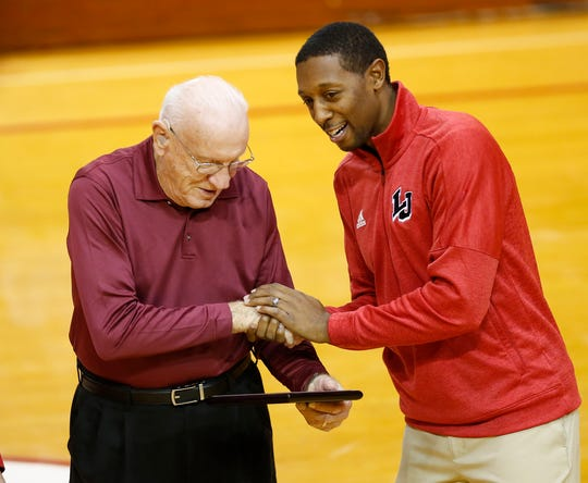 Dr. George Underwood is recognized by Lafayette Jeff athletic director Peyton Stovall during the halftime of the Bronchos game against Indianapolis Metropolitan Wednesday, November 21, 2018, in Lafayette. Lafayette Jeff honored Dr. Underwood and his wife by naming the Athletic Training Room the Dr. George and Rosemary Underwood Athletic Training Room. Jeff defeated Metropolitan 79-63.