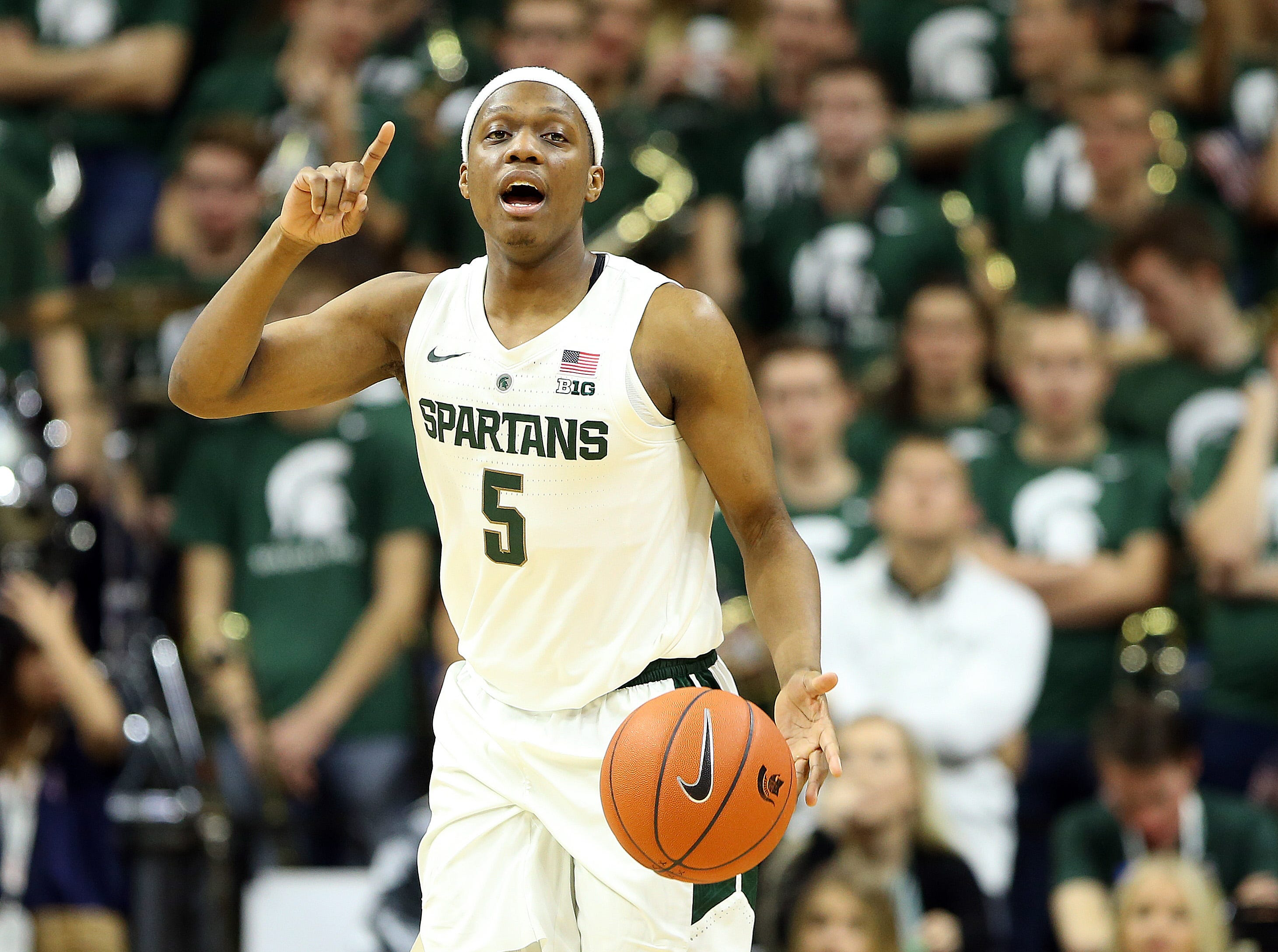Nov 11, 2018; East Lansing, MI, USA; Michigan State Spartans guard Cassius Winston (5) gestures during the second half of a game against the Florida Gulf Coast Eagles at the Breslin Center. Mandatory Credit: Mike Carter-USA TODAY Sports