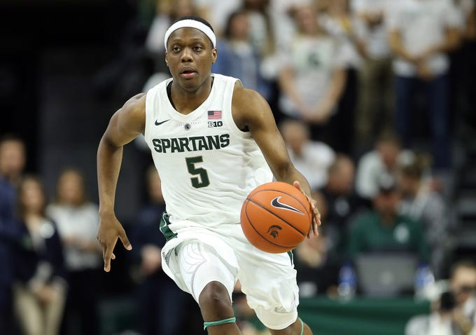 Nov 11, 2018; East Lansing, MI, USA; Michigan State Spartans guard Cassius Winston (5) brings the ball up court during the second half of a game against the Florida Gulf Coast Eagles at the Breslin Center. Mandatory Credit: Mike Carter-USA TODAY Sports