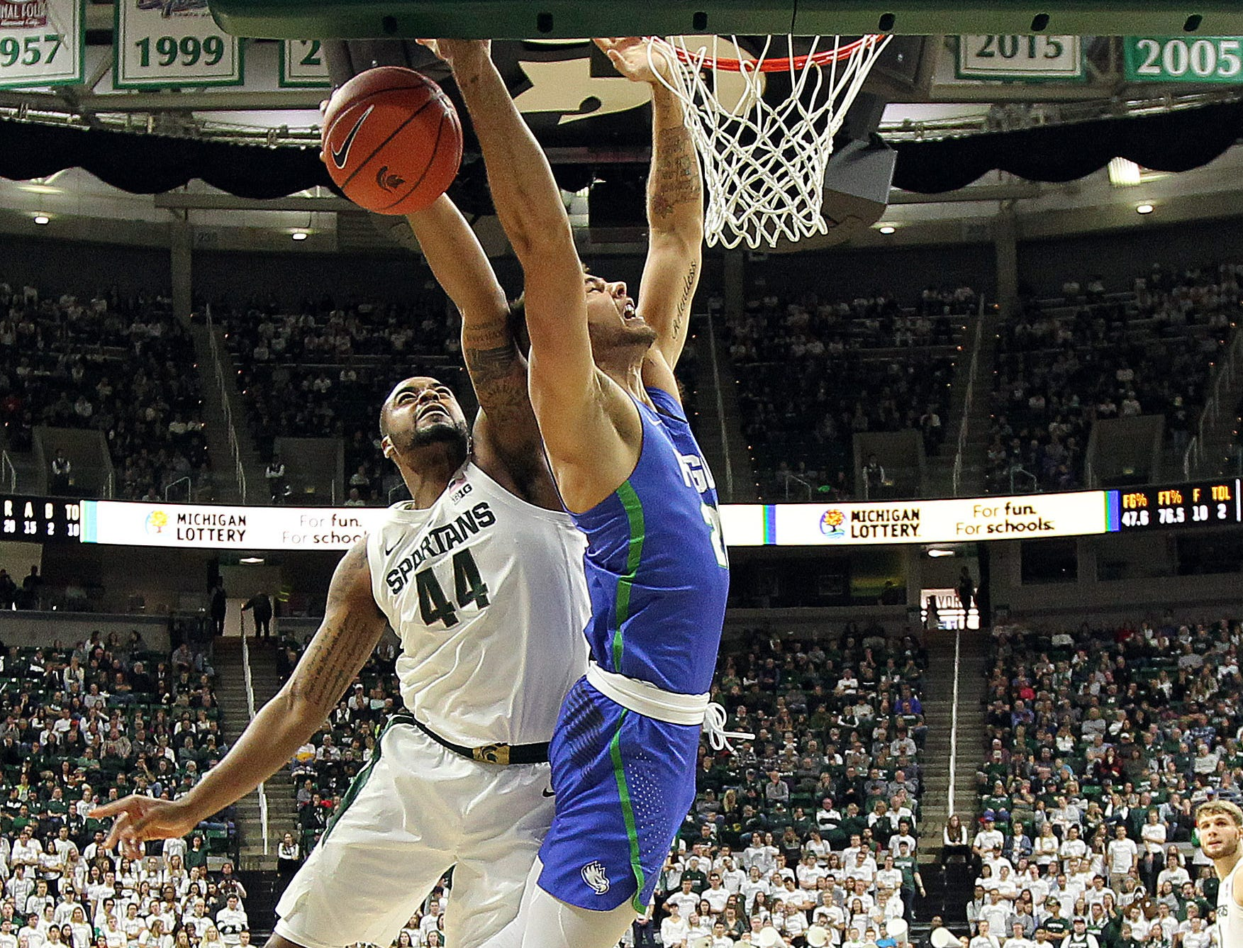 Nov 11, 2018; East Lansing, MI, USA; Michigan State Spartans forward Nick Ward (44) blocks the shot of Florida Gulf Coast Eagles forward Brady Ernst (21) during the second half of a game at the Breslin Center. Mandatory Credit: Mike Carter-USA TODAY Sports