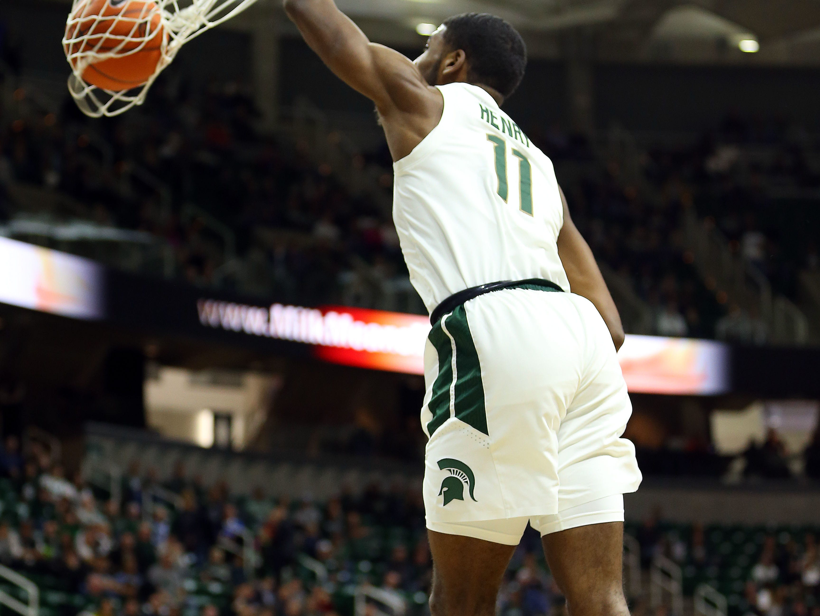 Nov 11, 2018; East Lansing, MI, USA; Michigan State Spartans forward Aaron Henry (11) dunks the ball against the Florida Gulf Coast Eagles during the second half of a game at the Breslin Center. Mandatory Credit: Mike Carter-USA TODAY Sports