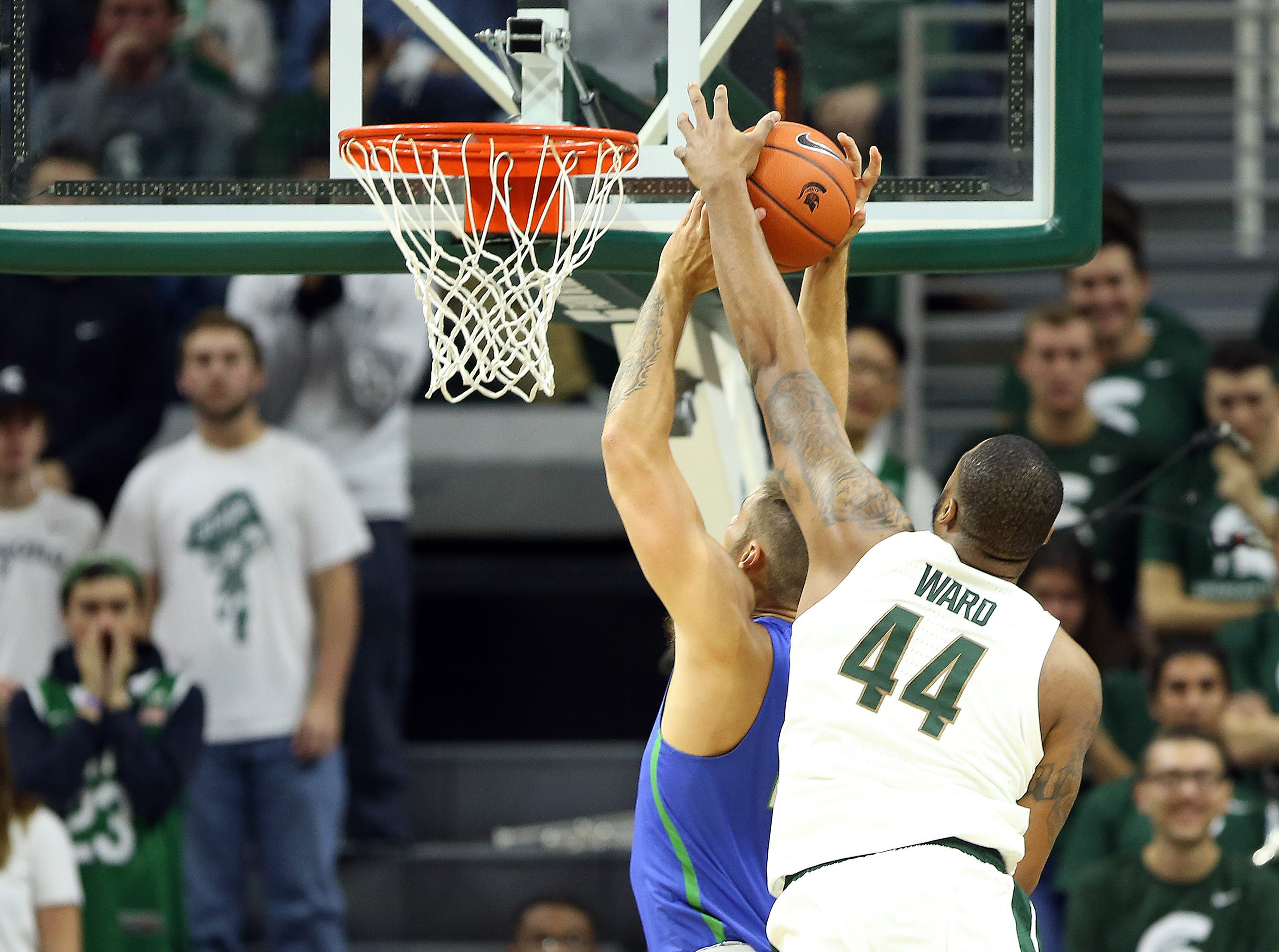 Nov 11, 2018; East Lansing, MI, USA; Michigan State Spartans forward Nick Ward (44) blocks the shot of Florida Gulf Coast Eagles guard Schadrac Casimir (11)during the second half of a game at the Breslin Center. Mandatory Credit: Mike Carter-USA TODAY Sports