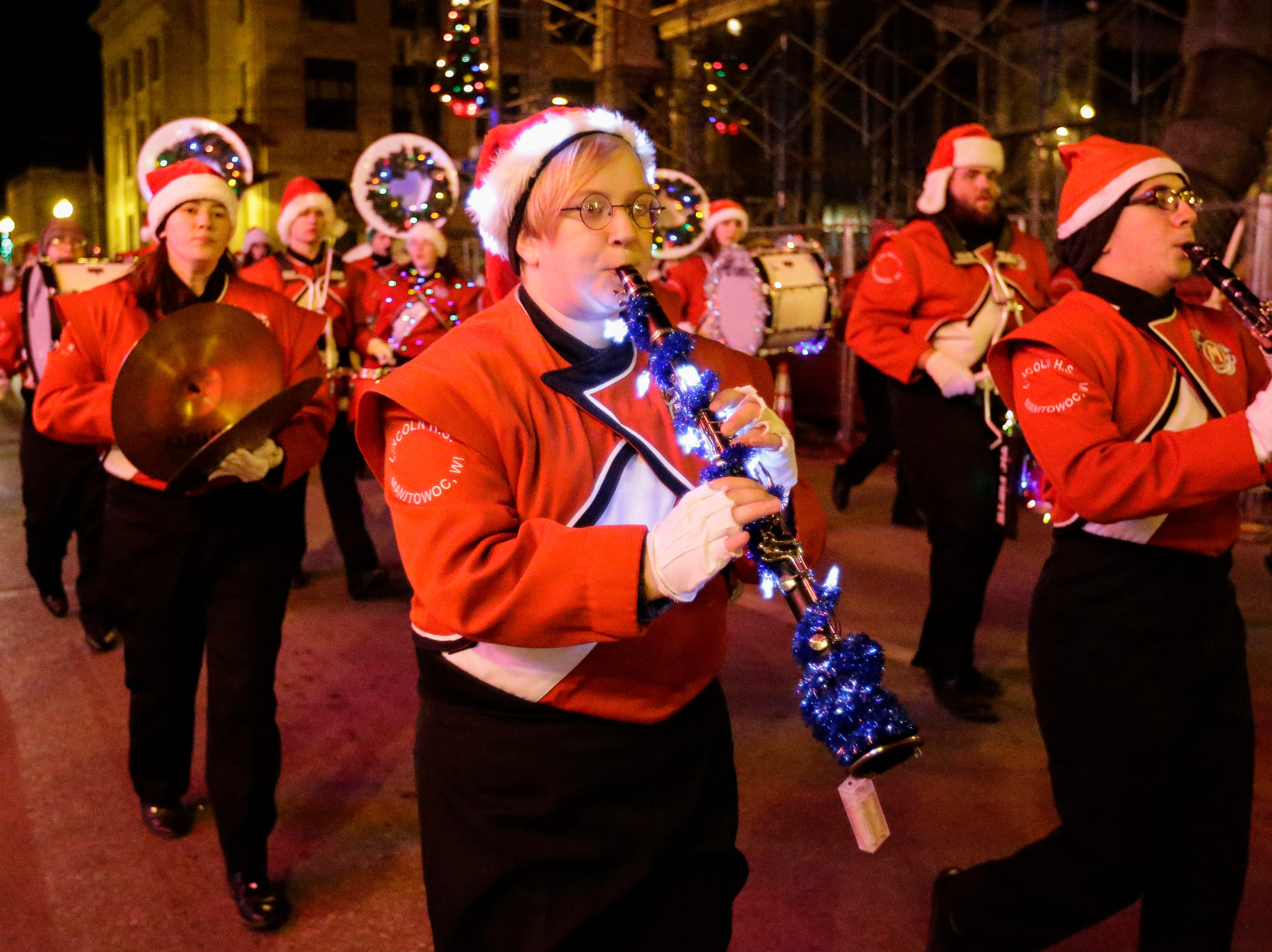 """The Manitowoc Lincoln High School marching band plays during the 30th Annual Lakeshore Holiday Parade Wednesday, November 21, 2018, in Manitowoc, Wis. This year's theme was """"Christmas Through the Decades."""" Joshua Clark/USA TODAY NETWORK-Wisconsin"""