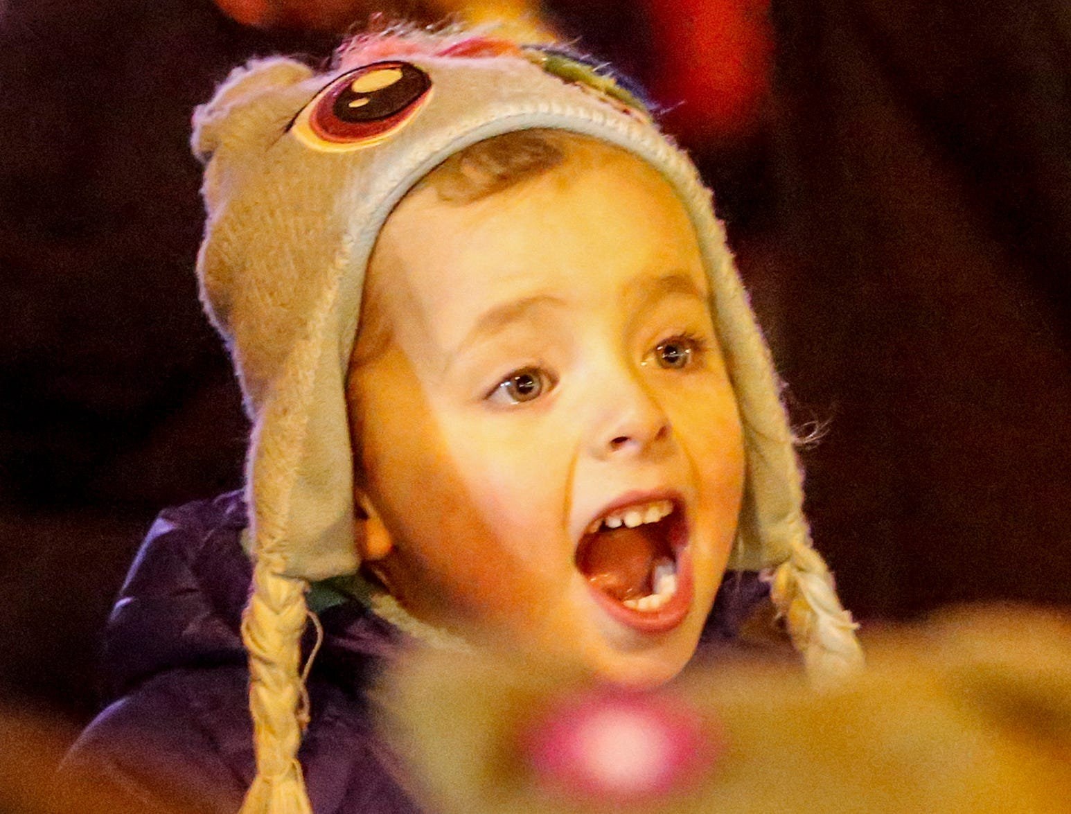 """Adelaide Wood, 5, of Madison, reacts to seeing Santa during the 30th Annual Lakeshore Holiday Parade Wednesday, November 21, 2018, in Manitowoc, Wis. This year's theme was """"Christmas Through the Decades."""" Joshua Clark/USA TODAY NETWORK-Wisconsin"""