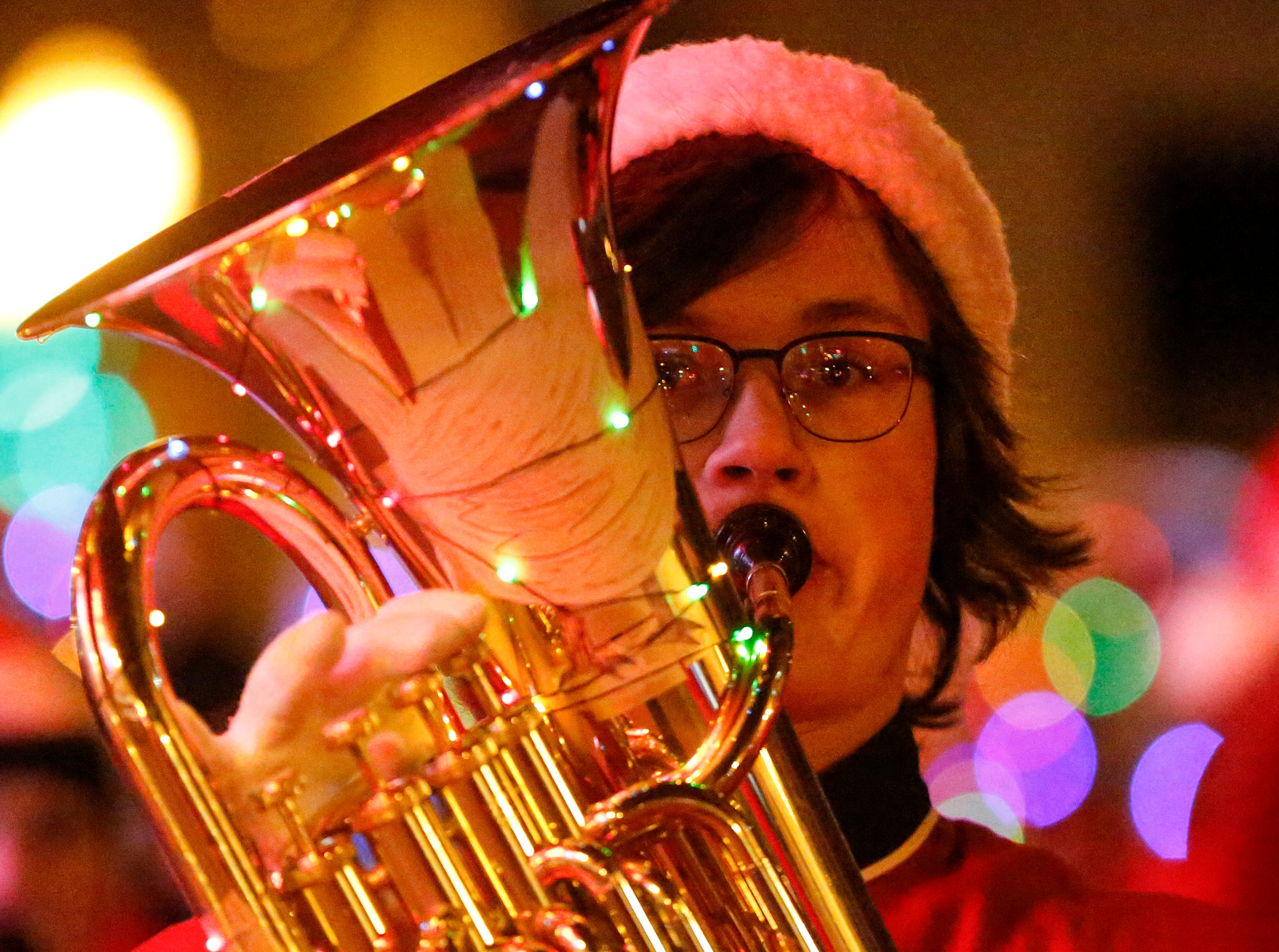 "The Manitowoc Lincoln High School marching band plays during the 30th Annual Lakeshore Holiday Parade Wednesday, November 21, 2018, in Manitowoc, Wis. This year's theme was ""Christmas Through the Decades."" Joshua Clark/USA TODAY NETWORK-Wisconsin"