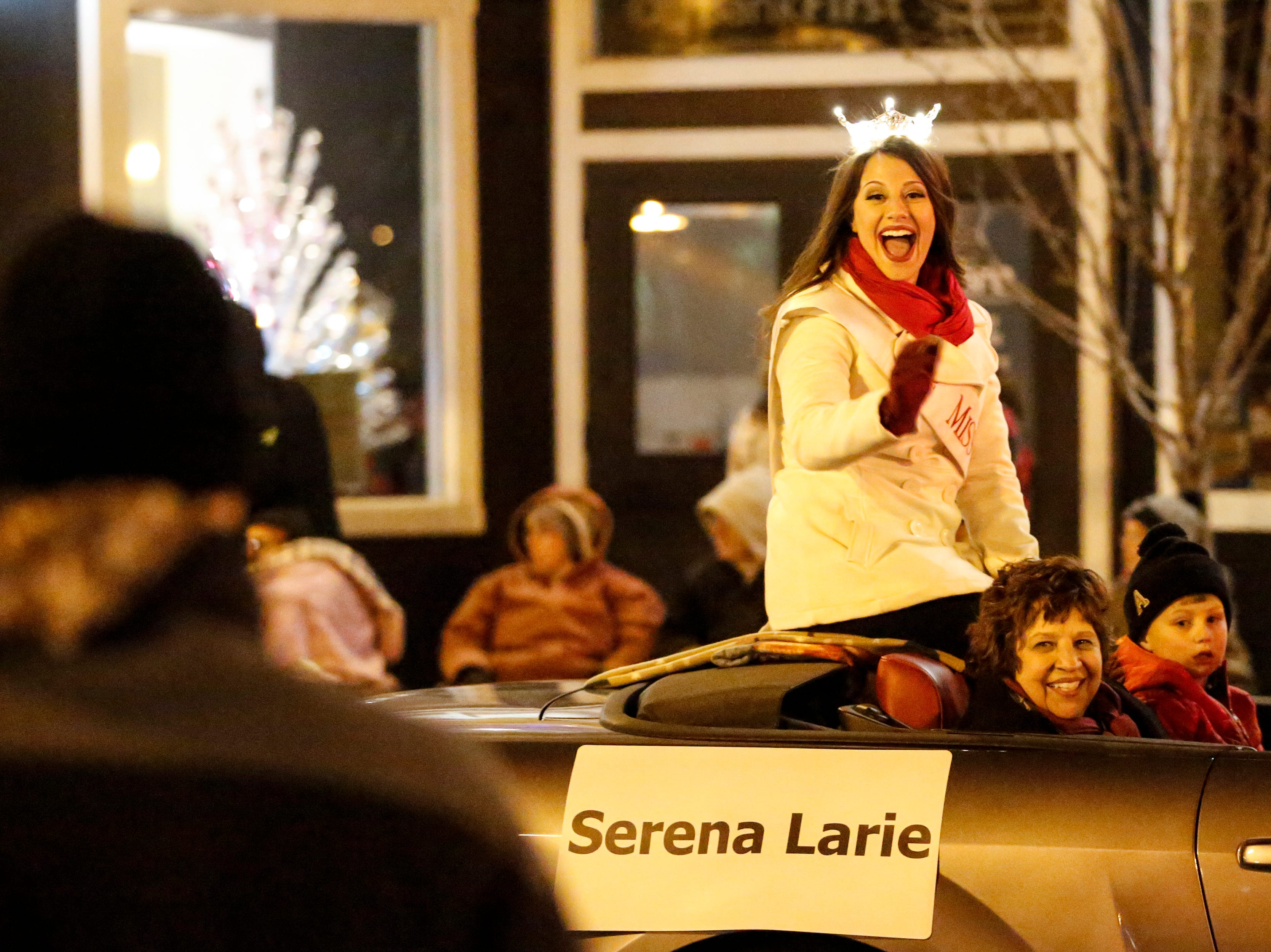 """Miss Harbor Cities Serena Larie waves to fans during the 30th Annual Lakeshore Holiday Parade Wednesday, November 21, 2018, in Manitowoc, Wis. This year's theme was """"Christmas Through the Decades."""" Joshua Clark/USA TODAY NETWORK-Wisconsin"""