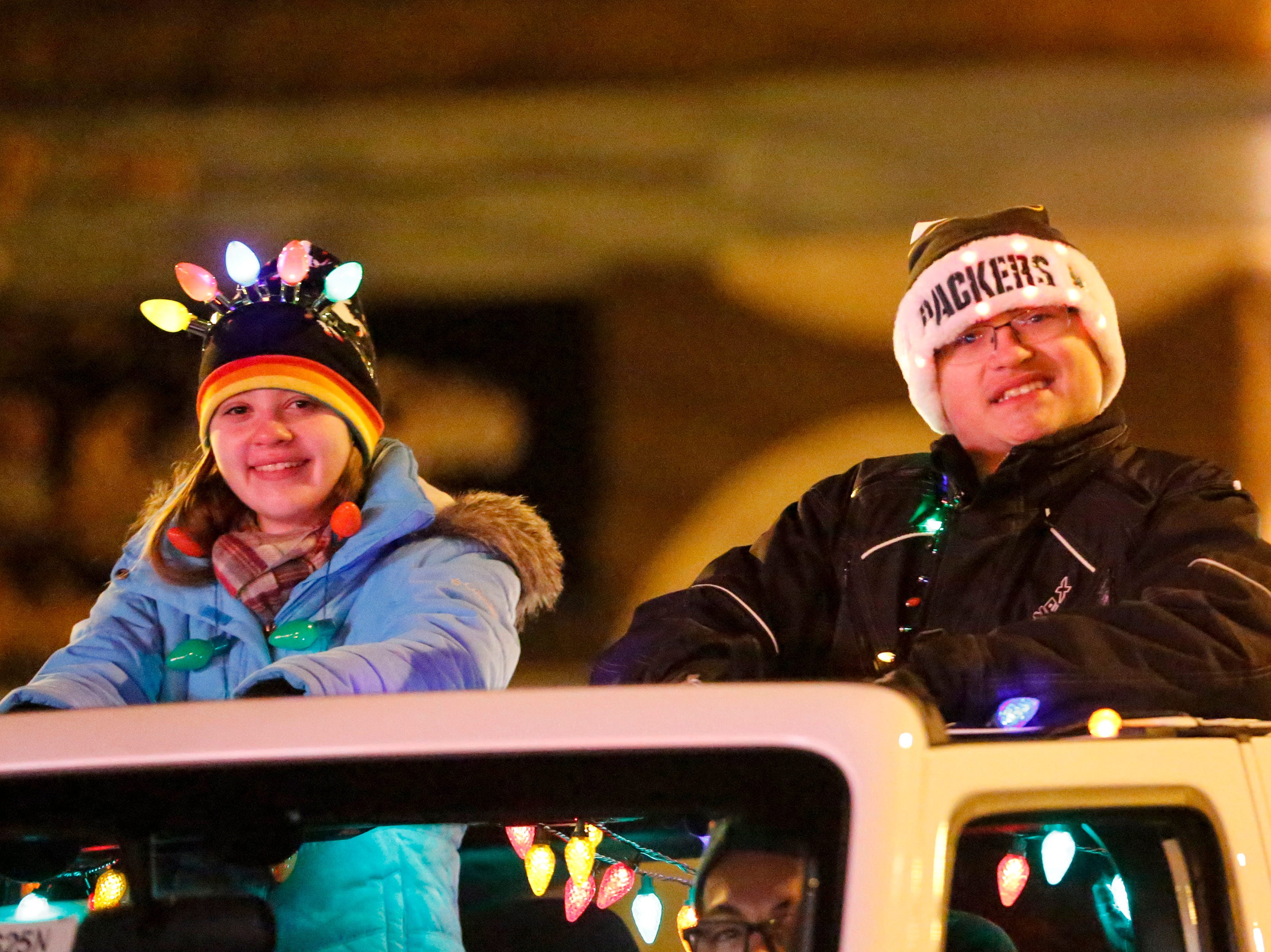 """Parade marshals lead the 30th Annual Lakeshore Holiday Parade Wednesday, November 21, 2018, in Manitowoc, Wis. This year's theme was """"Christmas Through the Decades."""" Joshua Clark/USA TODAY NETWORK-Wisconsin"""