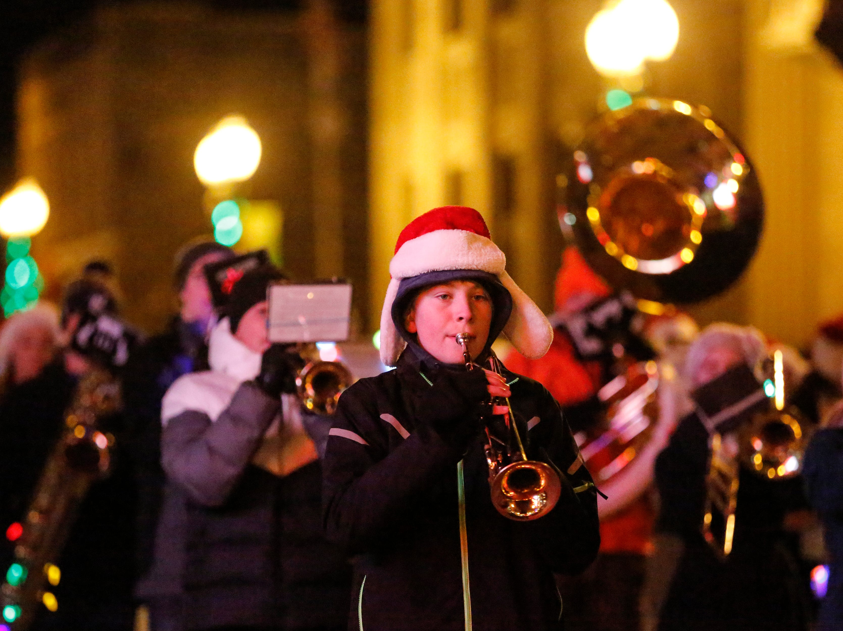 """The Roncalli marching band plays during the 30th Annual Lakeshore Holiday Parade Wednesday, November 21, 2018, in Manitowoc, Wis. This year's theme was """"Christmas Through the Decades."""" Joshua Clark/USA TODAY NETWORK-Wisconsin"""
