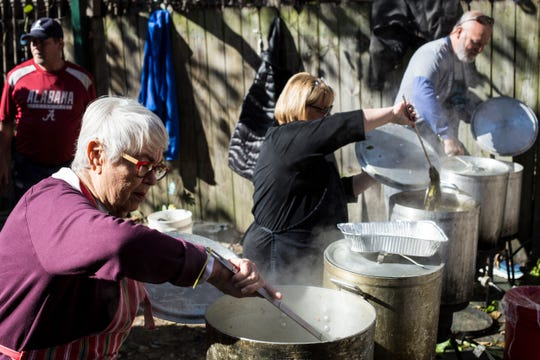 November 22 2018 - From left, Avis Brown, Becky Craft, and Buddy Craft stir pots of food while helping cook on Thanksgiving at Westy's Restaurant. Volunteers cooked, fed and handed out clothing items during the annual Thanksgiving tradition at Westy's.