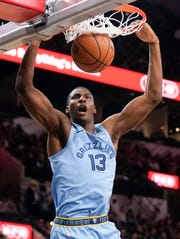Memphis Grizzlies' Jaren Jackson, Jr. dunks during the first half of the team's NBA basketball game against the San Antonio Spurs, Wednesday, Nov. 21, 2018, in San Antonio. (AP Photo/Darren Abate)