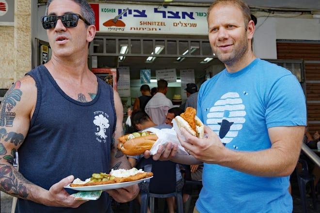 """Michael Solomonov (left) and Steven Cook wrote """"Israeli Soul: Easy, Essential, Delicious,"""" in which they explorethe roots of modern Israel bite by bite."""