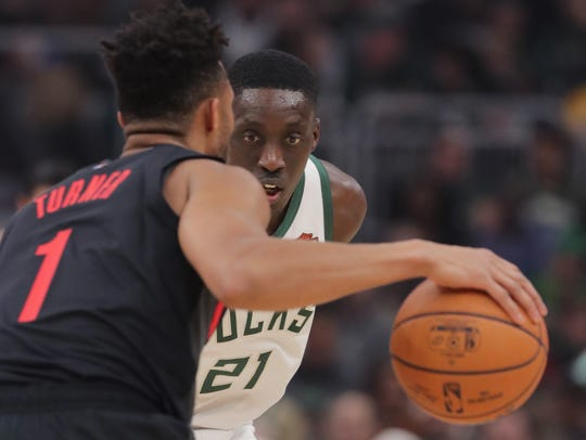 Milwaukee Bucks guard Tony Snell keeps a close watch on Portland Trail Blazers guard Evan Turner.