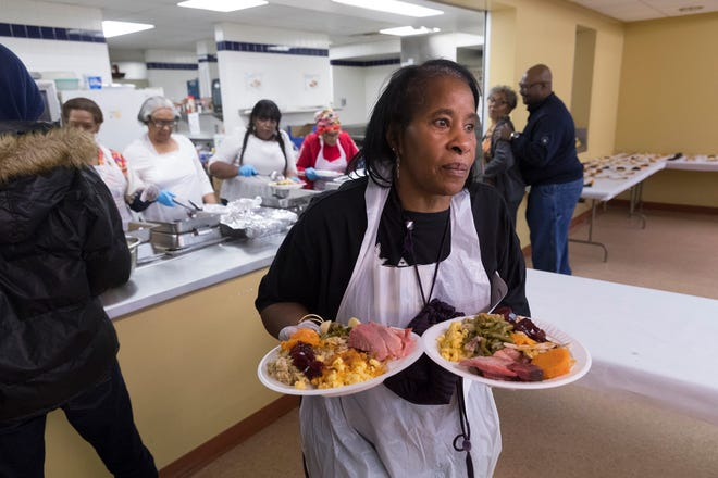 Volunteer Janette Herrera delivers meals to people who have mobility issues.
