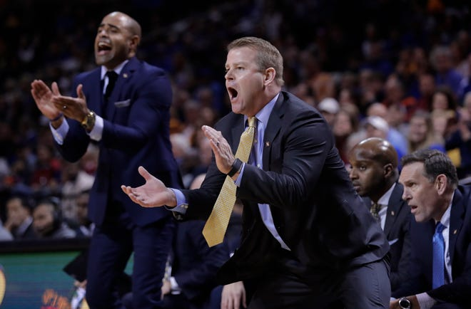 Marquette coach Steve Wojciechowski urges is team on in its game against No. 2 Kansas on Wednesday night.
