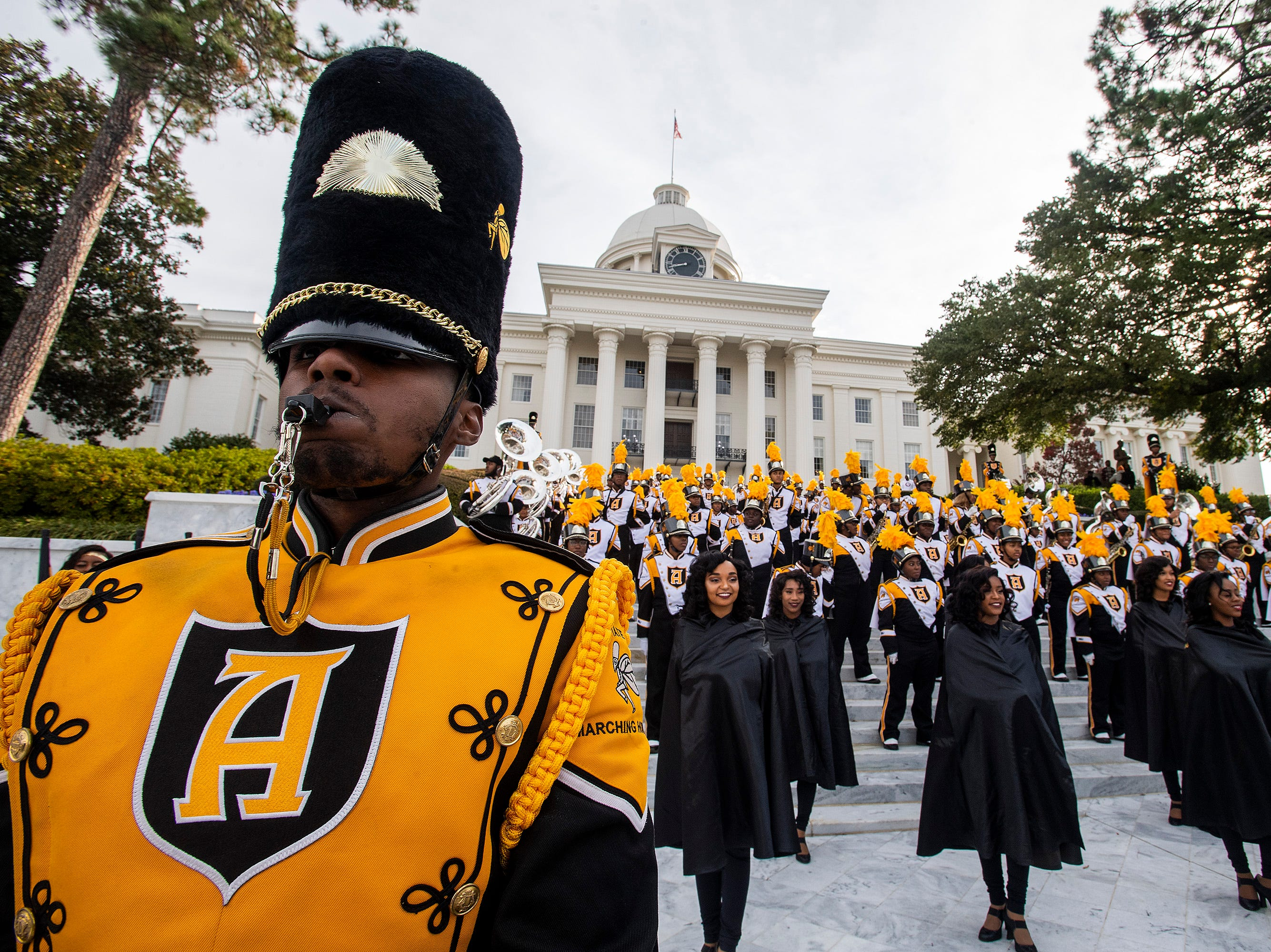 The Alabama State University Marching Hornets perform on the steps of the state capitol building before the Turkey Day Classic Parade in downtown Montgomery, Ala., on Thanksgiving Day, Thursday November 22, 2018.