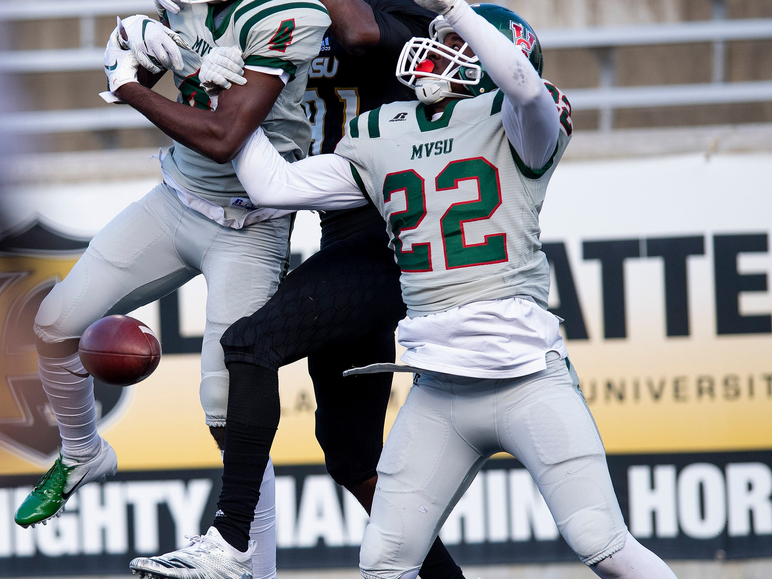 Mississippi Valley State defensive back Jonathan Jones (4)  and Jemaurri Bailey (22)  break up a p[ass intended for Alabama State University wide receiver Marquez Spencer (81) in first half action of the Turkey Day Classic at Hornet Stadium on the ASU campus in Montgomery, Ala., on Thanksgiving Day, Thursday November 22, 2018.