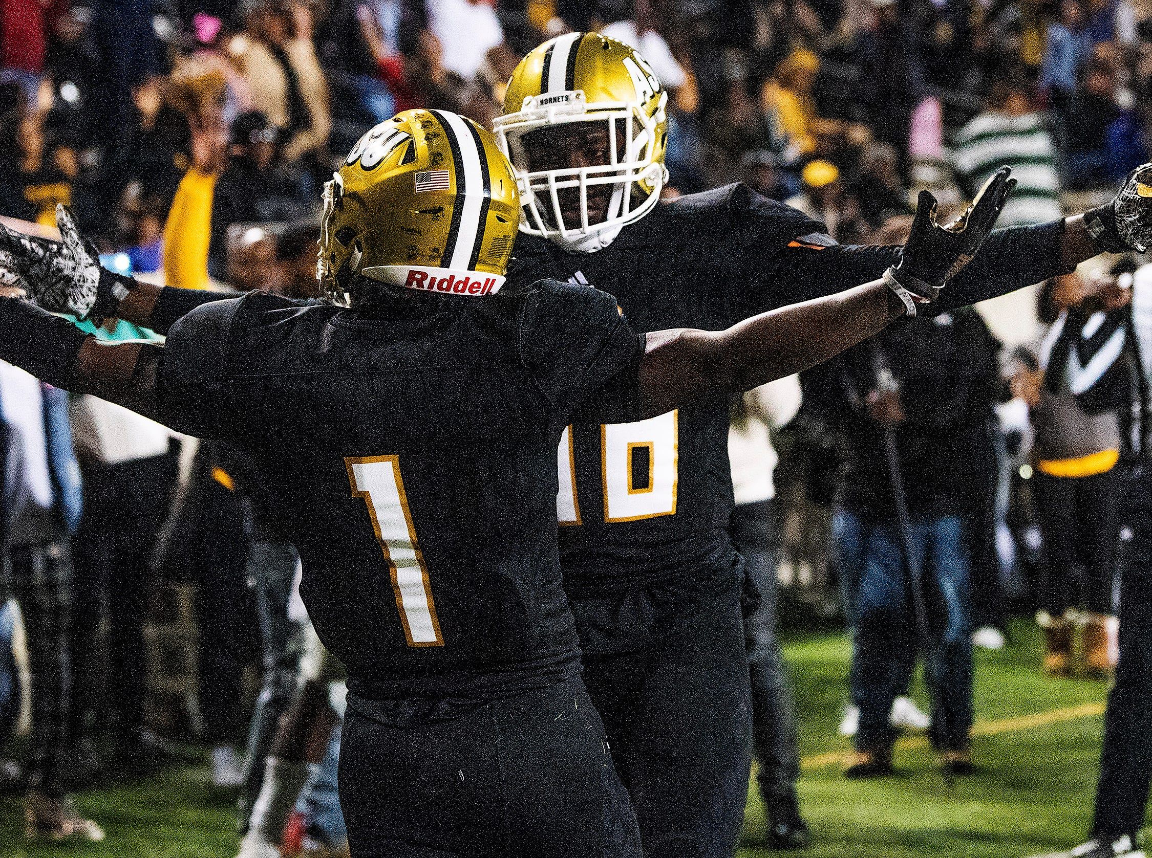 Alabama State University wide receiver Jeremiah Hixon (1)  and wide receiver Nygel Lee (88) celebrate Hixon's game winning touchdown in overtime against Mississippi Valley State in the Turkey Day Classic at Hornet Stadium on the ASU campus in Montgomery, Ala., on Thanksgiving Day, Thursday November 22, 2018.